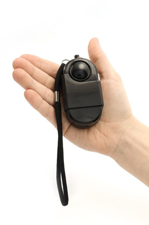 Ein Schlüsselalarm verfügt oft über eine Taschenlampe